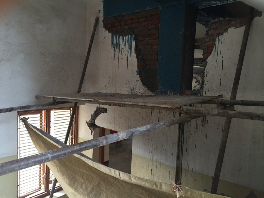 The school had experienced some damage from the earthquake, but it was being actively worked on for repairs. After entering the building and stepping through some scafolding, I climbed up the stairs to the teachers lounge and principal's office.  The building appeared to be stable.