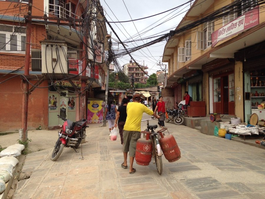 Another Kathmandu  street scene: getting fuel tanks refilled.